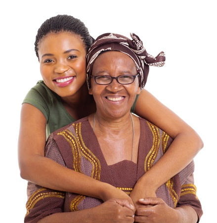 mother daughter: pretty african daughter hugging her senior mother over white background Stock Photo