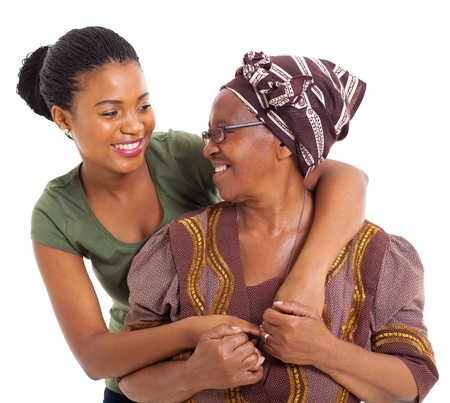 granny: happy african senior mother and adult daughter closeup portrait on white