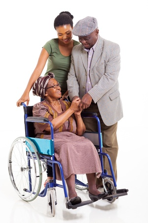 happy disabled senior african woman with husband and granddaughter on white background photo