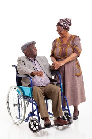 loving senior african wife talking to handicapped husband isolated on white photo