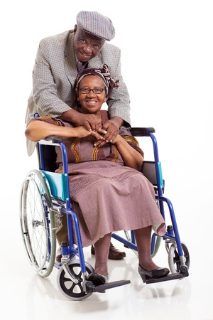 old black man: happy disabled senior african woman and her caring husband on white background Stock Photo