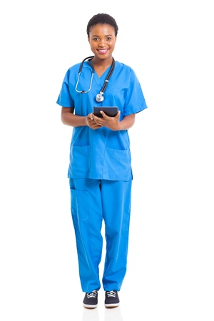 portrait of young african nurse with tablet computer isolated on white photo