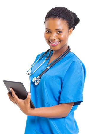 beautiful female african american medical nurse with tablet computer on white photo