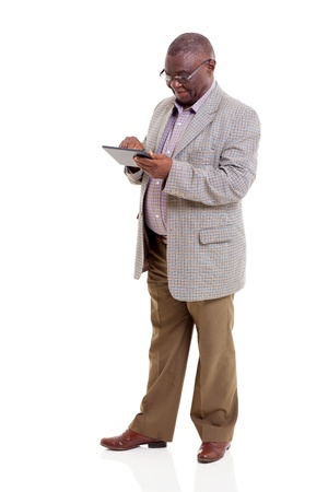modern african american old man using tablet computer on white background photo