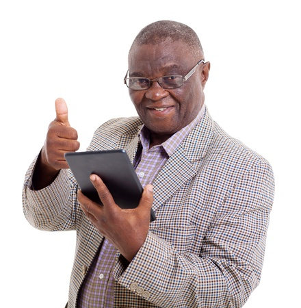 senior african man with tablet computer giving thumb up on white background photo