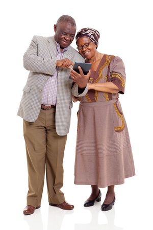 old african couple using tablet computer isolated on white photo