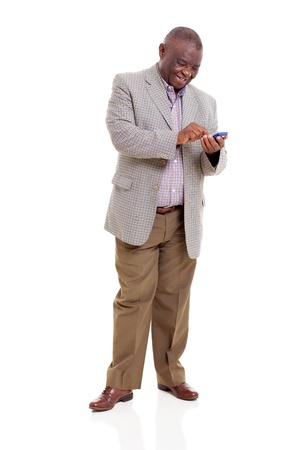 cutout old people: happy senior african man using smart phone isolated on white