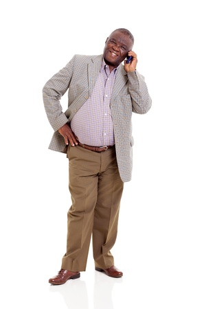 talking telephone: elderly african man talking on mobile phone isolated on white