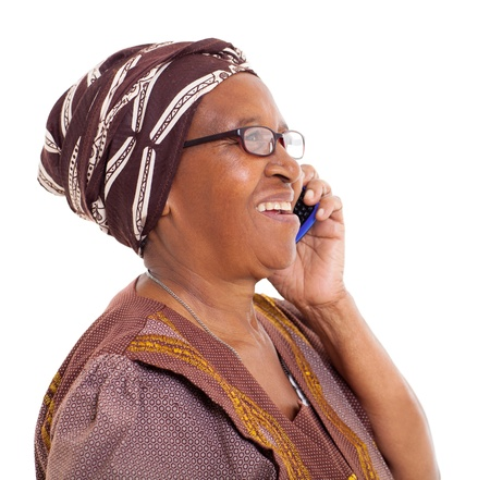 old cell phone: happy elderly african woman talking on smart phone on white background
