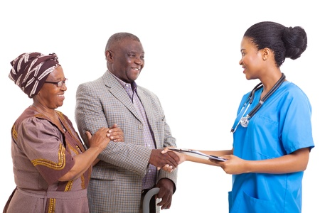 family doctor: friendly african nurse hand shake with senior patient and wife on white background