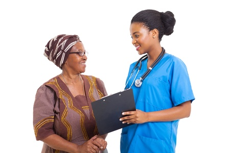 beautiful young african nurse helping senior woman with medical form photo