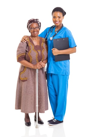 beautiful african nurse and senior patient isolated on white photo