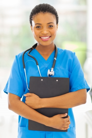 beautiful female african medical nurse holding clipboard photo