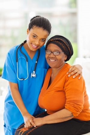 patient: friendly caring young african nurse and senior patient