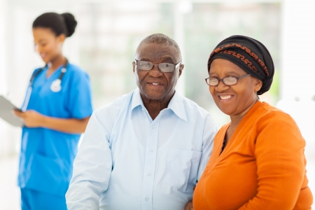 happy senior african couple in doctors office photo