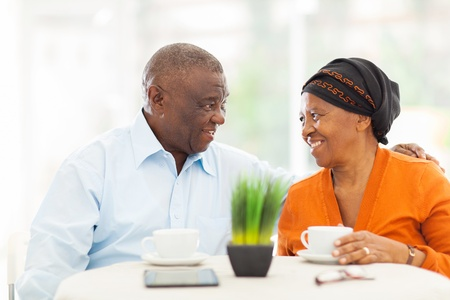 loving senior african couple relaxing at home photo