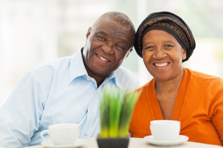 cute senior african couple portrait at home photo