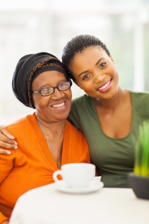 happy senior african woman with daughter at home Stock Photo