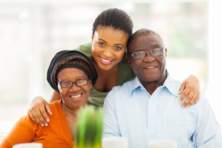 portrait of happy african family at home photo