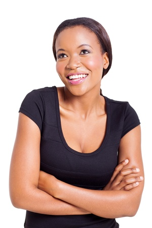 attractive young african american woman looking up on white background photo
