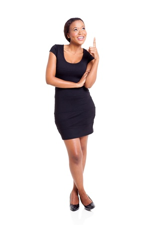 cheerful afro american businesswoman pointing up on white background photo