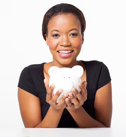 attractive young african american woman holding piggy bank on white background photo