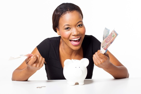 cheerful african woman with money isolated on white photo