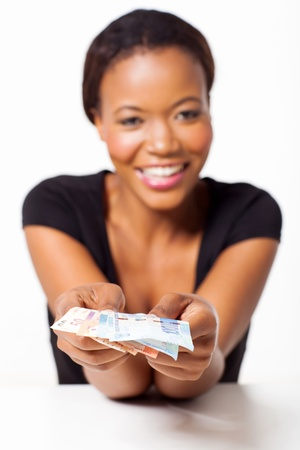 african american woman business: young black woman presenting south african money Stock Photo