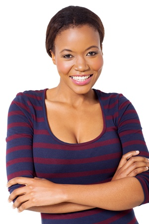 portrait of african american woman with arms folded against white background photo