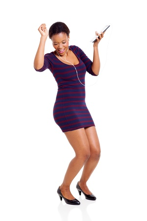 computer dancing: attractive african woman dancing with a tablet computer isolated on white