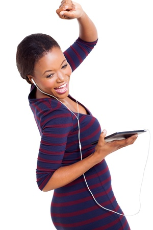 computer dancing: cheerful african woman dancing with tablet computer dancing