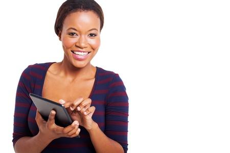 アフロアメリカン: 白い背景にタブレット コンピューターを使用してかなり若いアフロ ・ アメリカ人女性 写真素材