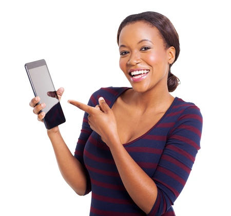 portrait of young african woman pointing at tablet computer isolated on white photo