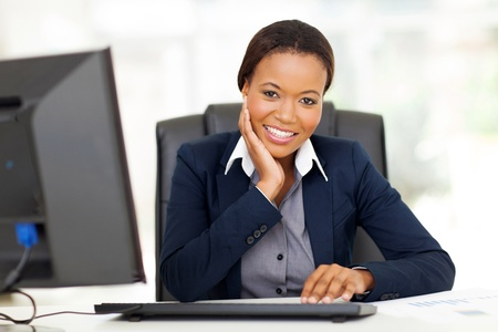 ethnic attire: attractive young african businesswoman in office