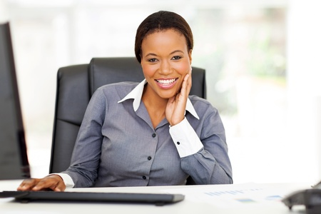 african american woman business: happy young african american businesswoman relaxing in office
