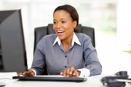 happy african american businesswoman working in modern office Stock Photo - 22138601