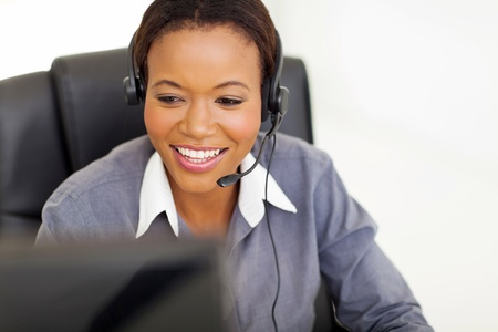 telephonist: happy african american telephonist in front of computer