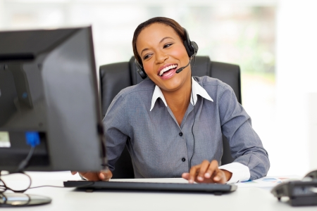 cheerful african call center operator with headphones Stock Photo - 22138608