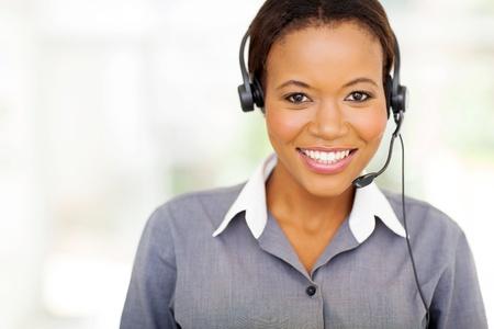 portrait of pretty african american call center operator photo