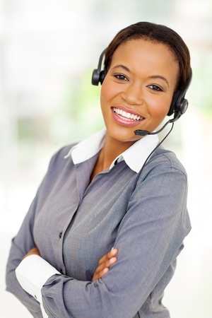 ethnic attire: happy afro american business call center operator with arms crossed