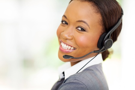 call center office: headshot of beautiful female african call center operator Stock Photo