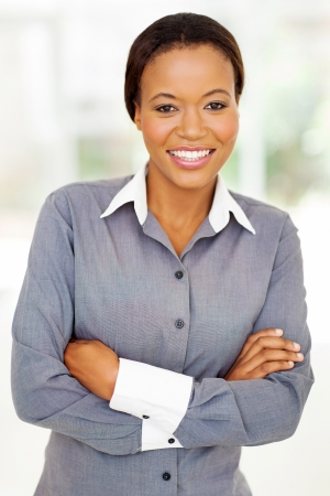 ethnic attire: pretty african american businesswoman in modern office