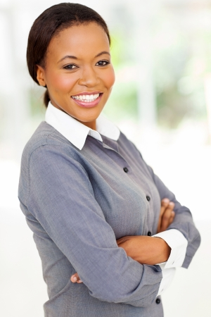 african business woman: attractive afro american woman with arms folded looking at the camera