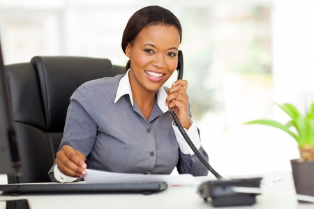 phone professional: attractive female african office worker talking on phone
