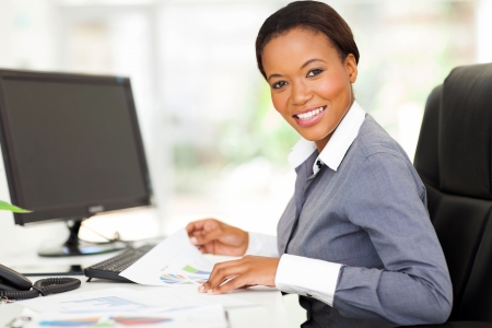 beautiful young african office worker in modern office Stock Photo - 22138668