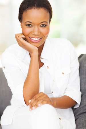 ethnic attire: beautiful african american woman sitting at home