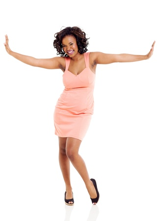 cheerful african woman with arms outstretched on white background photo