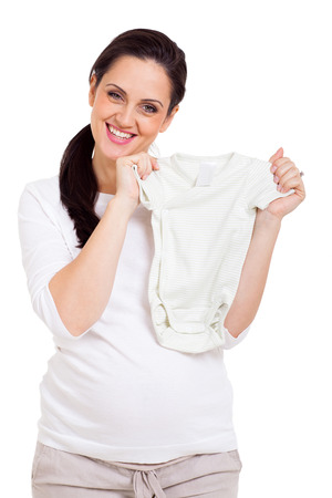 rompers: happy pregnant woman holding baby clothes white background