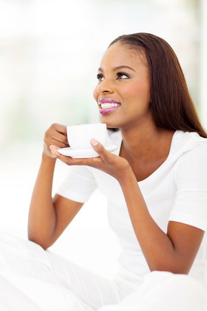 thoughtful africa american female drinking hot coffee photo