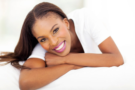 african beauty: beautiful african american woman lying on bed Stock Photo